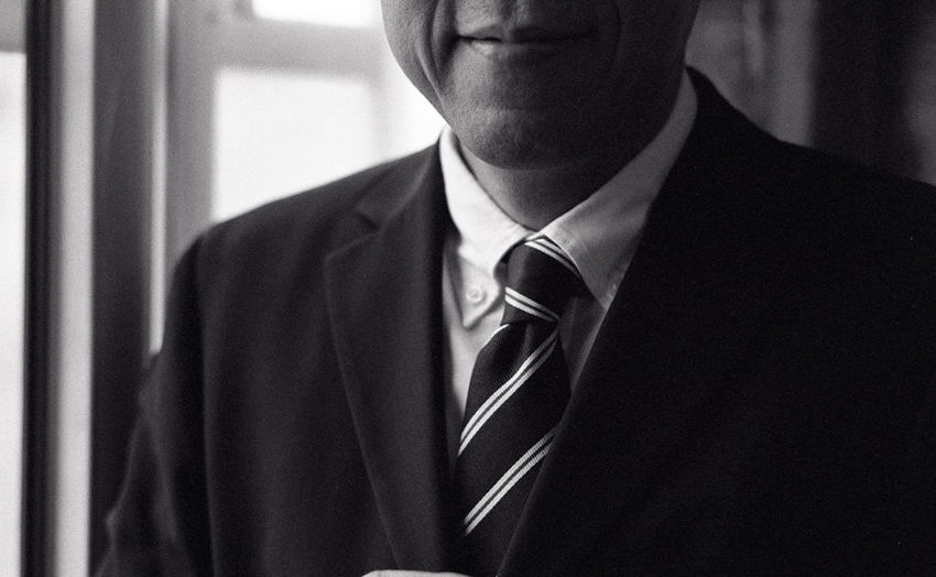 Midsection of smiling man wearing suit