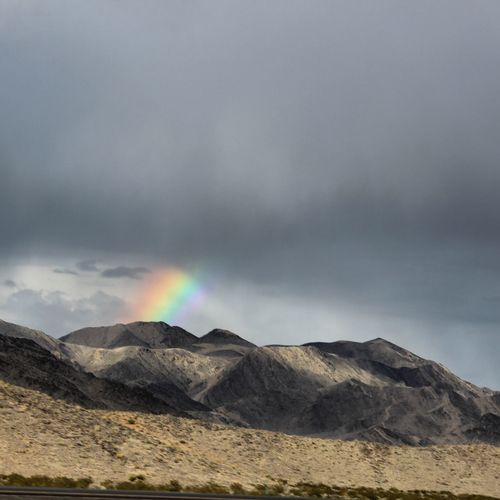 Scenic view of mountains against rainbow
