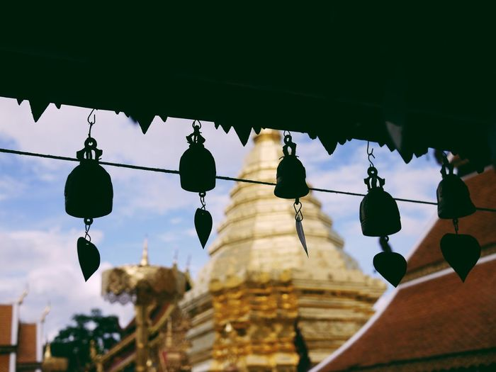 Low angle view of decorations hanging against wat phrathat doi suthep
