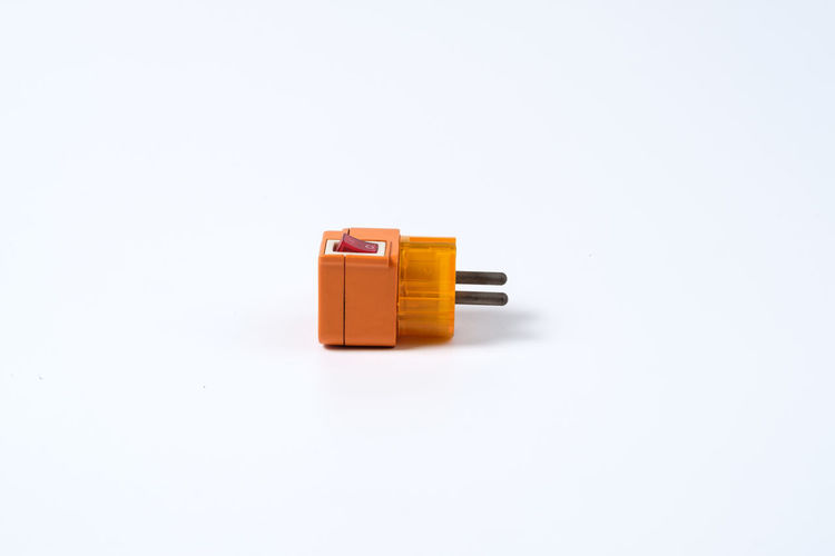 Cable Color Connect Electric Connection Converter Electric Electric Converter Electric Slot Electrical Engineer Engineering Equipment High Voltage Orange Slot Voltage Watt White Background Studio Shot Copy Space Indoors  Single Object Still Life Cut Out No People Toy Close-up Orange Color Plastic Technology Man Made Container Yellow Electricity  Small