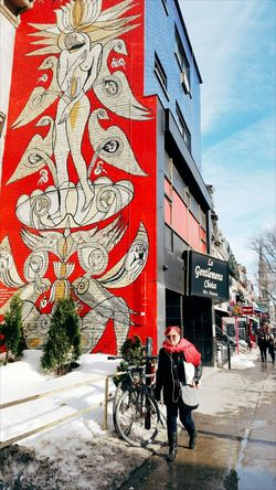 Building Exterior Outdoors Red City Streetart Streetart/graffiti Canada Snow Melting Walking Walking Around The City  Redscarf ArtWork Bicycle Sunglasses Day Matching Colors Colours Colors Architecture Built Structure