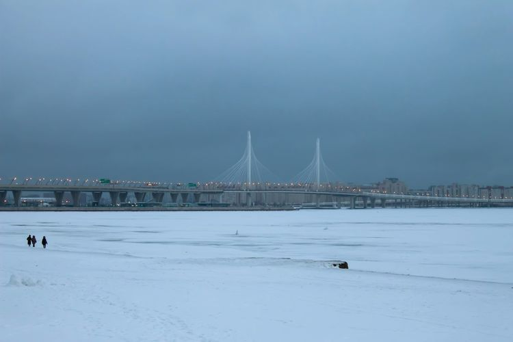 Bridge - Man Made Structure Cityscape Urban Skyline Cold Temperature Snow Winter Beach Sea City Business Finance And Industry Seascape Man Made Structure Horizon Over Water Frozen Water Street Light Construction Coast Building Feature