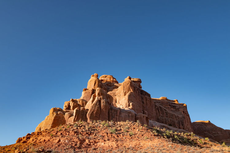 Red rock formations against blue sky in arches national park utah usa