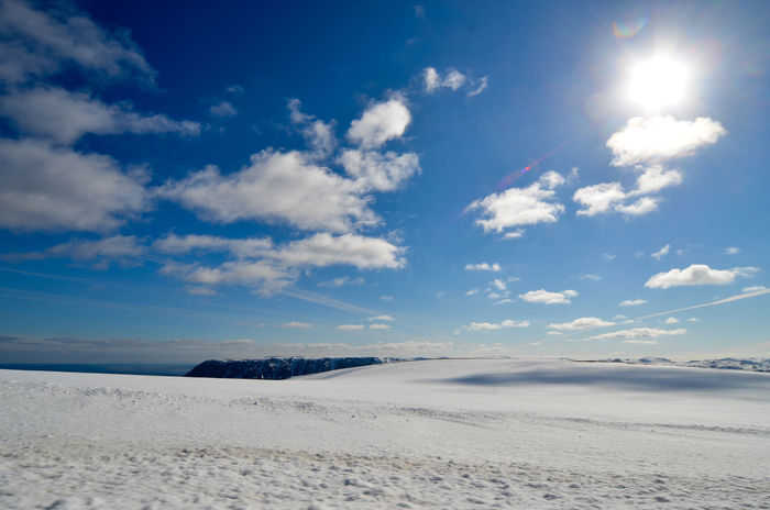 Beauty In Nature Blue Cold Temperature Covering Day Lens Flare Nature Non-urban Scene Nordic Nordkapp North Cape Scenics Sea Season  Sky Snow Snow Covered Sun Sunbeam Sunny Tourism Tranquil Scene Tranquility Vacations Winter