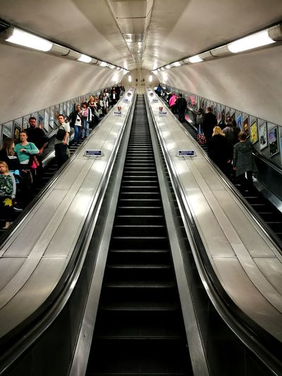 LONDON❤ City Low Angle View Built Structure Escalators And Staircases Architecture Indoors  Arch Travel Tourism People Real People Crowd Transportation London Underground Escalators Stairs The Week On EyeEm Single Point Perspective Geometry