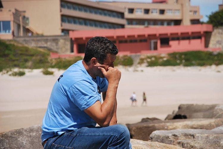 Man sitting at beach