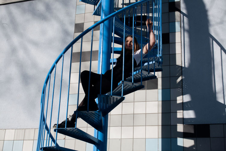 Low angle view of spiral staircase of building in city