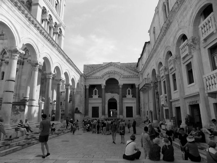 While I was on my trip to island Vis, I traveled through the beautiful town of Split, had a short stop at Diocletian`s palace, beautiful, what can I say more. Diocletian Palace EyeEmNewHere Arch Architectural Column Architecture Building Exterior Built Structure History Large Group Of People Outdoors People Real People Split Croatia Travel Destinations Summer Road Tripping The Architect - 2018 EyeEm Awards
