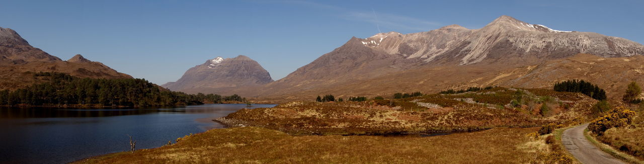 Loch  Road Beauty In Nature Day Landscape Mountain Mountain Range Nature No People Outdoors Scenics Sky Torridon Mountains Tranquil Scene Tranquility Tree Water
