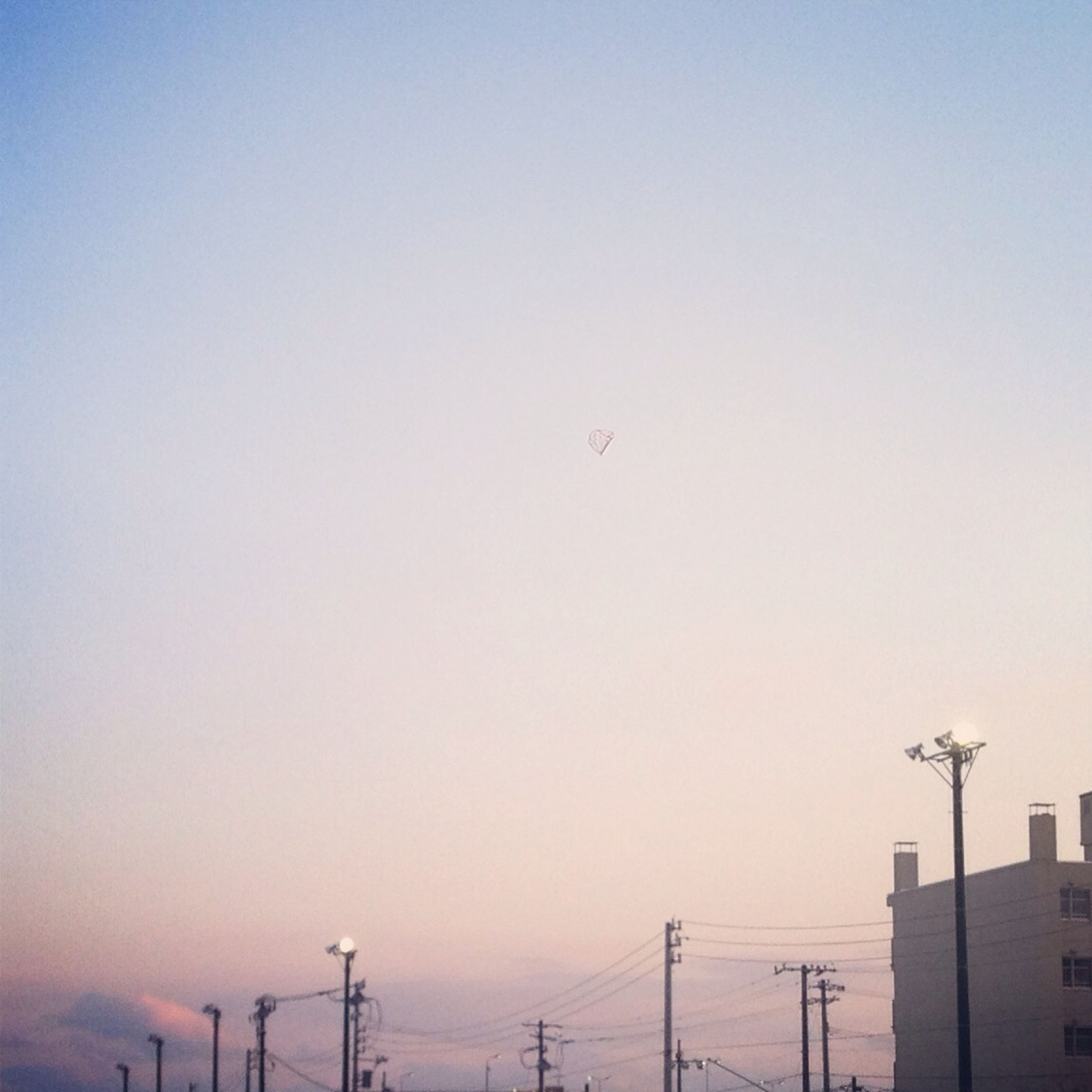 clear sky, copy space, low angle view, silhouette, sunset, technology, connection, fuel and power generation, electricity, sky, electricity pylon, power line, dusk, crane - construction machinery, outdoors, nature, industry, built structure, no people, street light