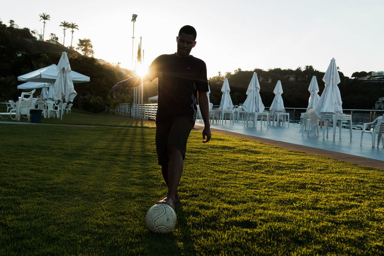 Man playing soccer on field at park