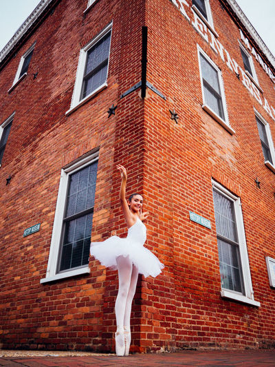 Get the Pointe Architecture Ballerina Ballet Brick Wall Building Building Exterior Built Structure Composition Culture Exterior Glass - Material Low Angle View March Showcase Old Pointe Shoes Window Showcase March