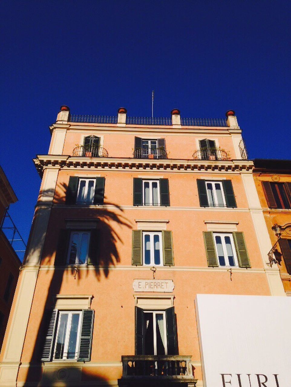 building exterior, architecture, built structure, window, low angle view, sky, clear sky, building, blue, no people, city, nature, facade, residential district, sunlight, outdoors, day, shadow, sunny, balcony, apartment