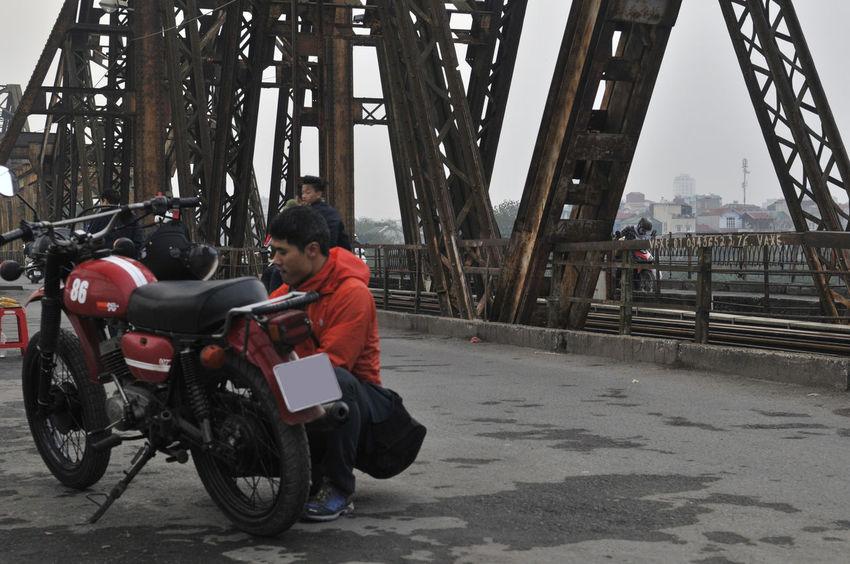 Asian  Motorcycle Motorcycle Repair Red Working Bridge Built Structure Day Eiffel Girders Iron Rusting Helmet Hoody Land Vehicle Lifestyles Motor Bike Outdoors Real People Red Color Transportation