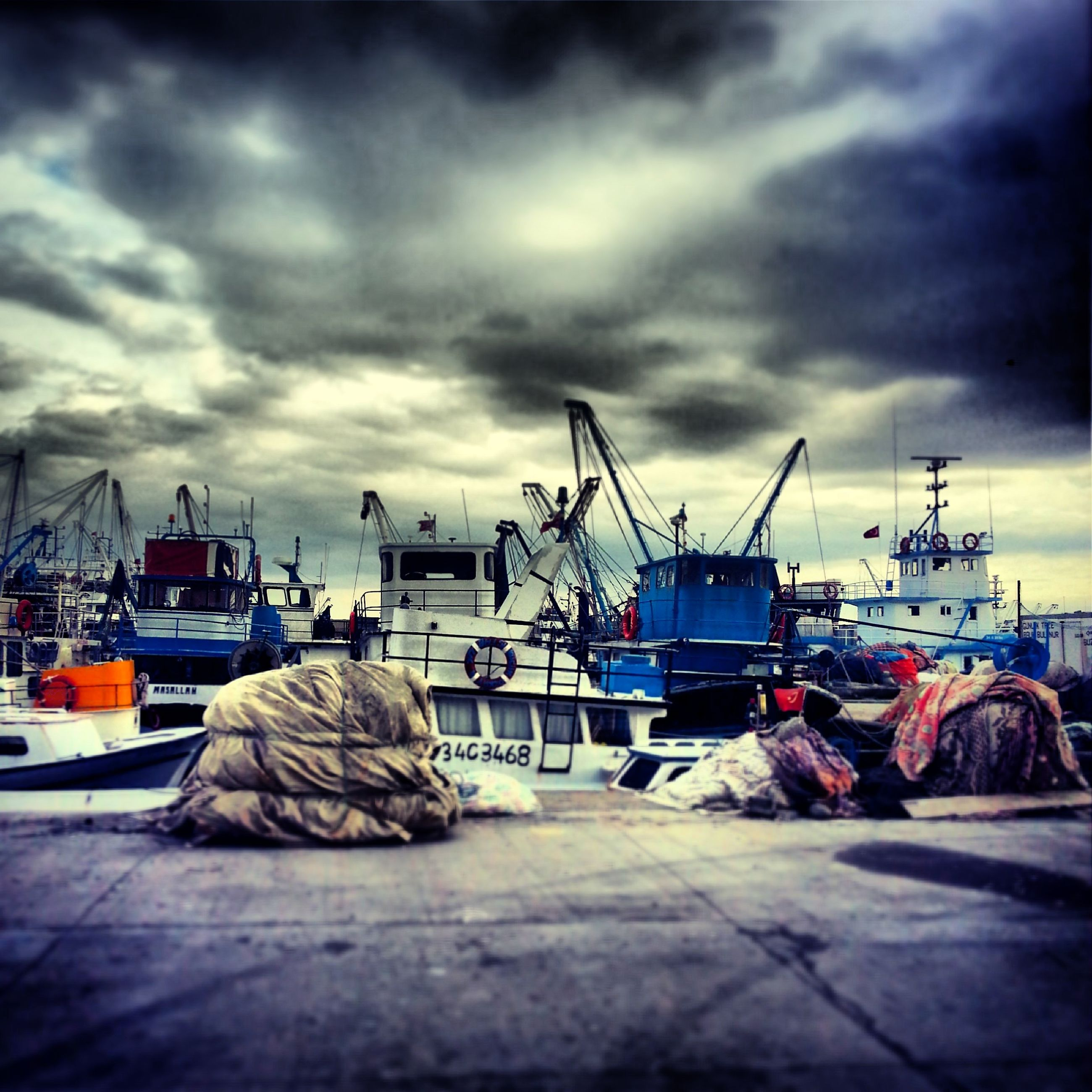 sky, transportation, nautical vessel, mode of transport, cloud - sky, cloudy, moored, boat, cloud, harbor, overcast, weather, sea, fishing industry, outdoors, day, mast, in a row, group of objects, travel
