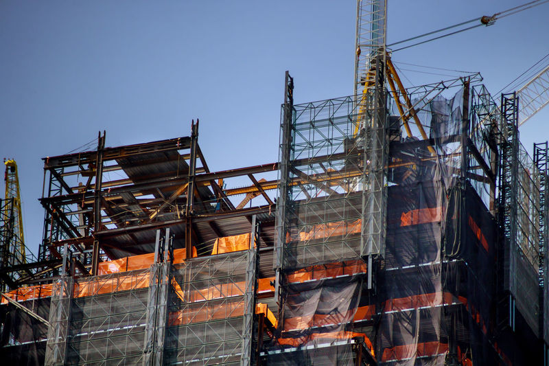 Low angle view of construction site against sky