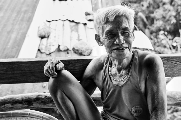Black And White Friday Senior Adult One Person Outdoors Day Looking At Camera Real People Sitting Portrait Smiling Gray Hair Close-up People Adult Adults Only Adventures In The City Focus On The Story