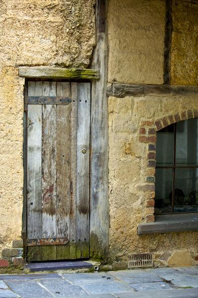 Weathered wooden door, part of a building