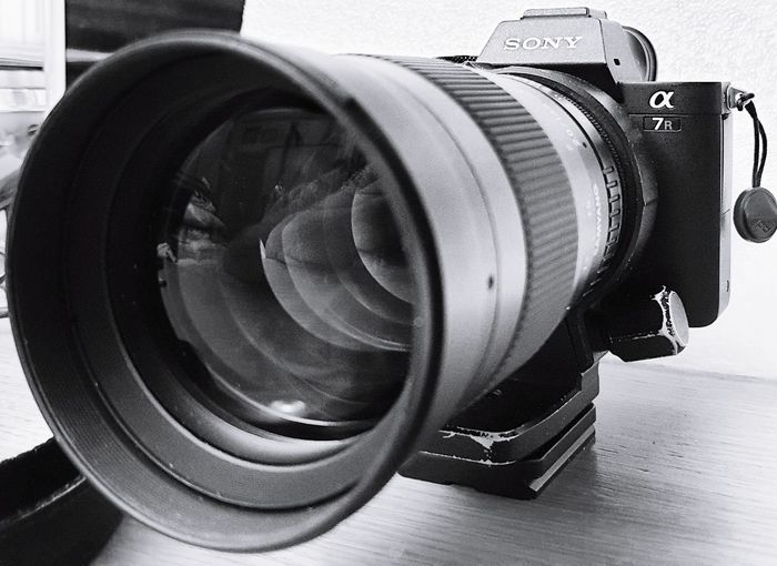 Close-up of camera on table