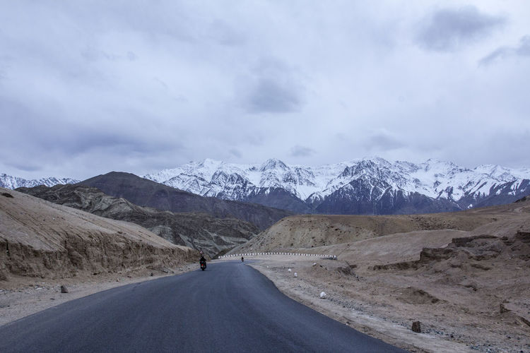 Road Mountain Transportation Sky Snow Beauty In Nature Scenics - Nature Cloud - Sky Cold Temperature Environment Mountain Range Direction Winter The Way Forward Landscape Non-urban Scene Tranquil Scene Nature Snowcapped Mountain Diminishing Perspective No People Outdoors