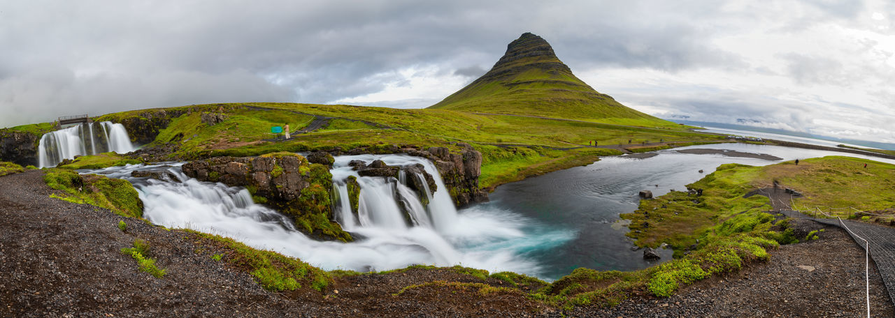 Panoramic view of Kirkjufellfoss and Kirkjufell mountain in cloudy day ,Iceland. Iceland Kirkjufell Kirkjufellsfoss Beauty In Nature Cloud - Sky Environment Flowing Flowing Water Icelandic Land Landscape Long Exposure Mountain Mountain Peak Nature No People Outdoors Scenics - Nature Sea Sky Tranquil Scene Travel Destinations Volcano Water Waterfall