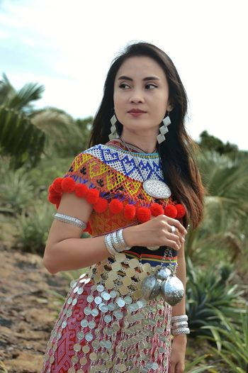 Close-up of woman wearing traditional clothes while standing on field