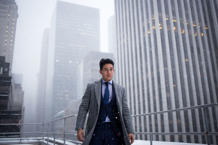 Suit Supply F/W collection outfit I shot in recent NYC snowfall. White Architecture Businessman City Cold Corporate Business Fashion HDR Men Mens Model Modelling New York New York City Portrait Roof Rooftop Snow Style Style ✌ Suit Suit Supply Well-dressed White Winter