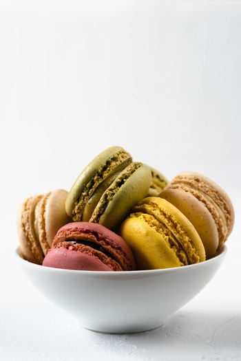 macarons in a bowl infront of a with background   food photography Food And Drink Macaroon Food Sweet Food Dessert Sweet Temptation Ready-to-eat Unhealthy Eating No People Still Life Close-up Snack White Background Studio Shot Indoors  Macarons Food Photography Foodphotography negative space Colorful