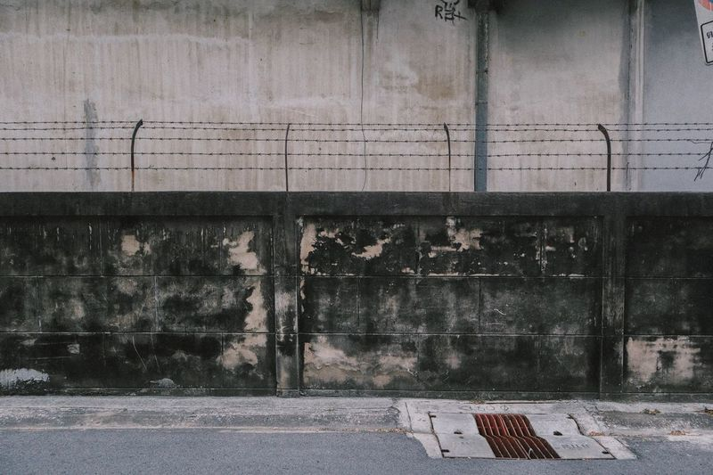 Abandoned building against wall