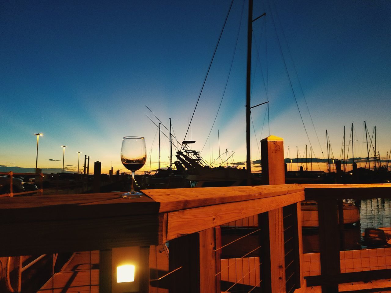 sunset, no people, sky, dusk, outdoors, blue, nautical vessel, wine, wineglass, clear sky, architecture, day, water, nature, wine cask
