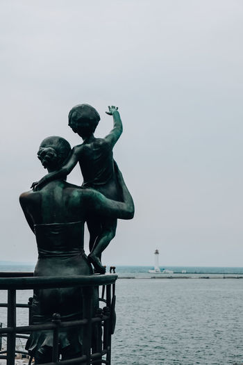 Statue of sea against clear sky