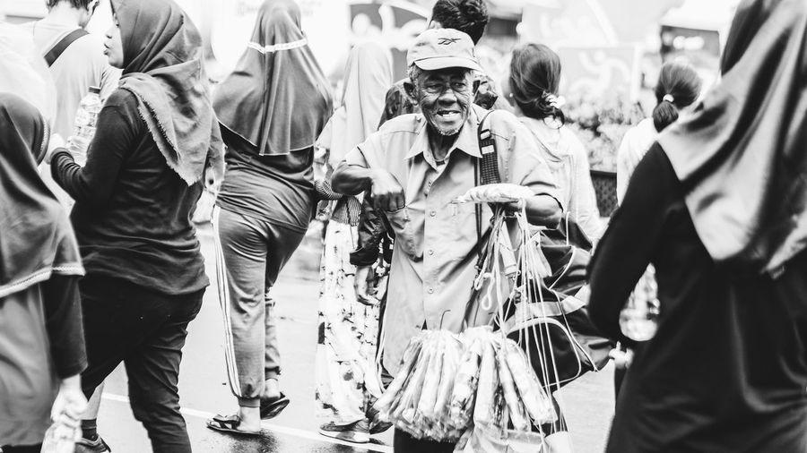 the struggle Stretphotography Streetvendor Old Oldman Oldmanportrait The Street Photographer - 2018 EyeEm Awards Crowd Men Women Celebration Parade