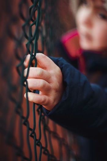 Holding metal fence