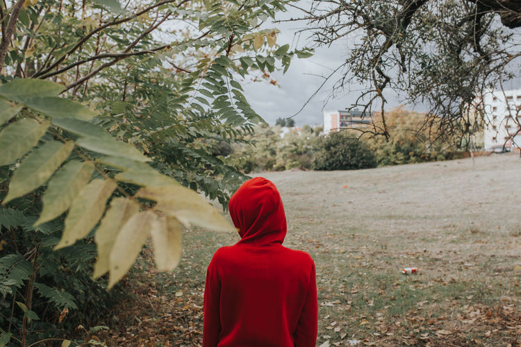 Alone Alone Time Alone In The City  Red Standing Day Hood - Clothing Hooded Shirt Nature People Real People Rear View Red Red Color Standing Alone Tree Watching Women