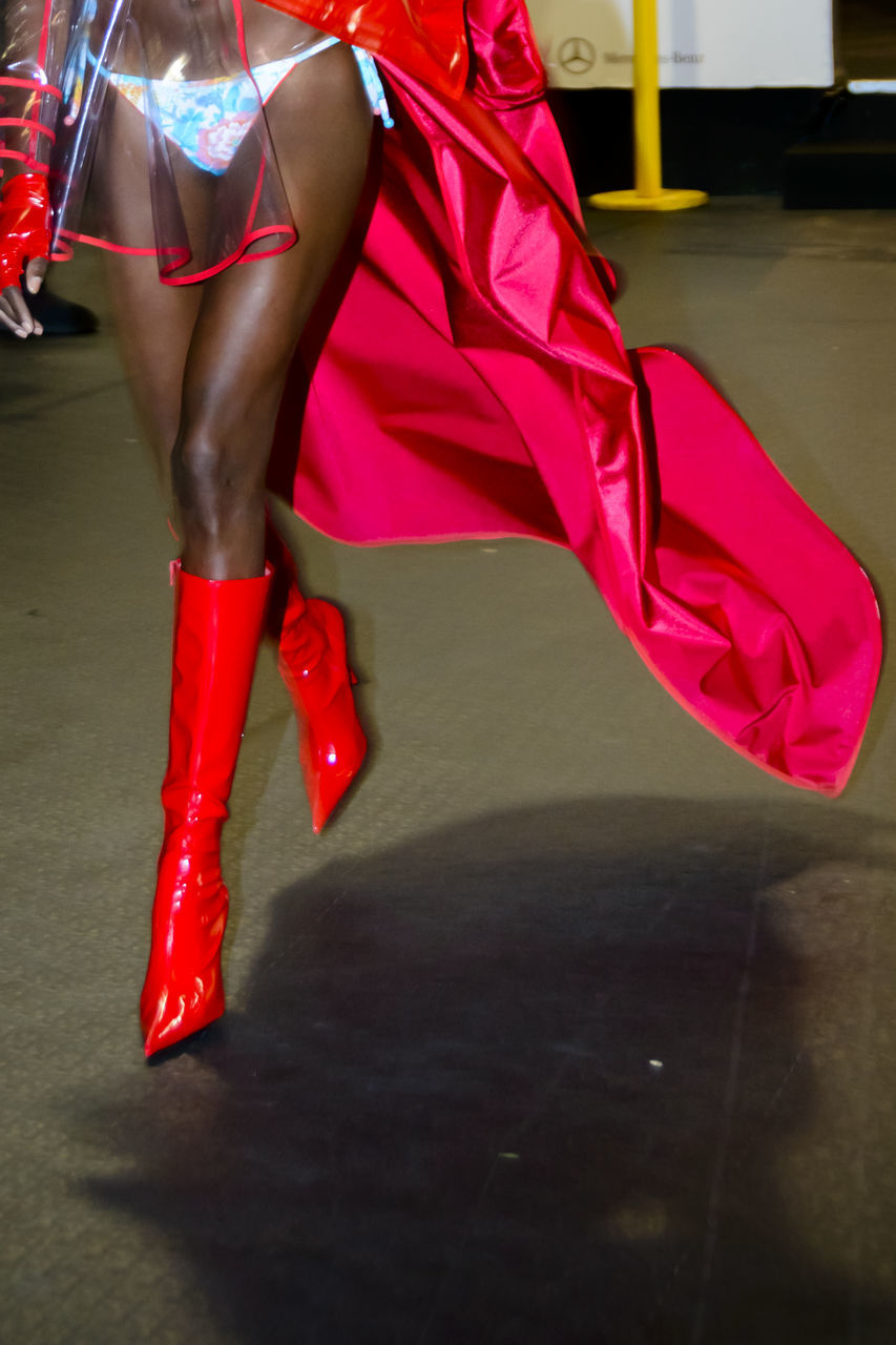 women, red, one person, fashion, real people, low section, high heels, adult, human leg, clothing, lifestyles, human body part, body part, shoe, indoors, leisure activity, dress, beauty, human limb