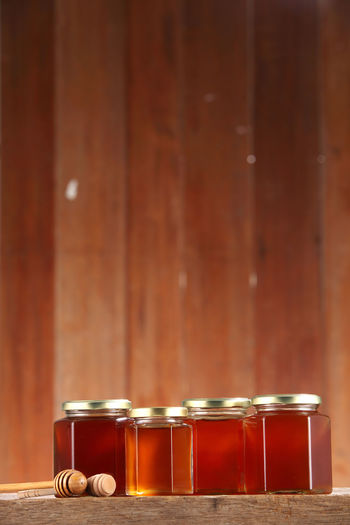 Close-up of honey in jars on table