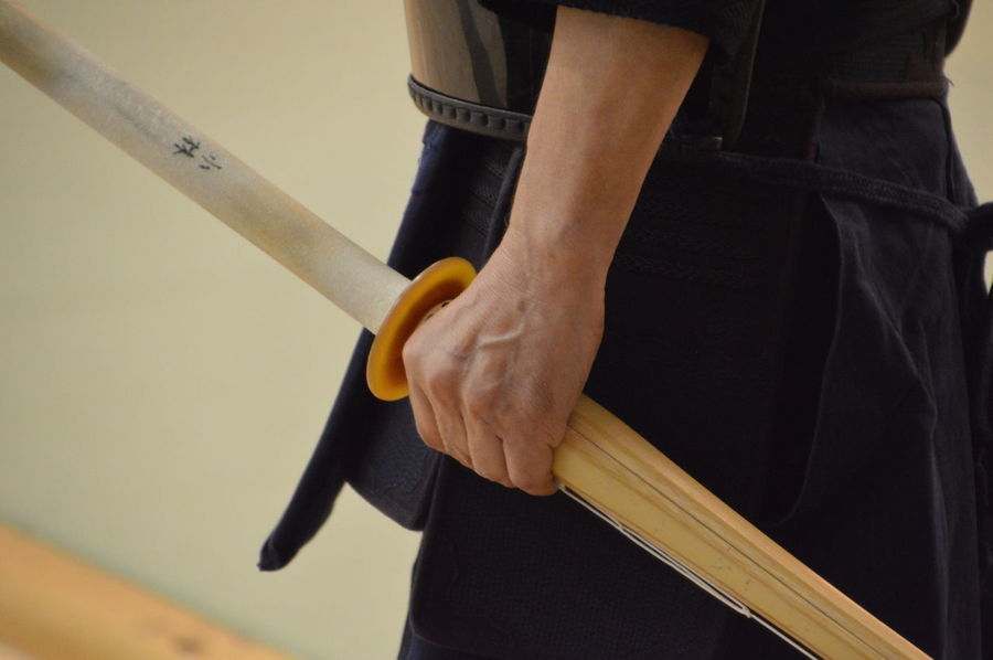Japanese Man Holding Kendo Sword In His Hand Japan Japanese  Kendo Man Martial Arts Wood Arts Budo Budokan Close-up Hand Hold Holding Human Hand Kendoka Midsection Sword Wooden
