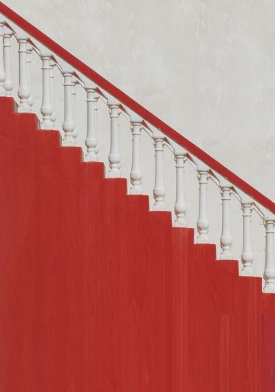 View of staircase against red wall