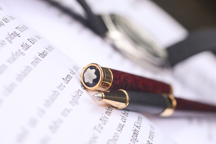 Selective Focus Paper Document Close-up Text Indoors  No People Still Life Writing Instrument Pen Event Communication Focus On Foreground Ring Wedding Life Events Finance Western Script White Color Reading Writing