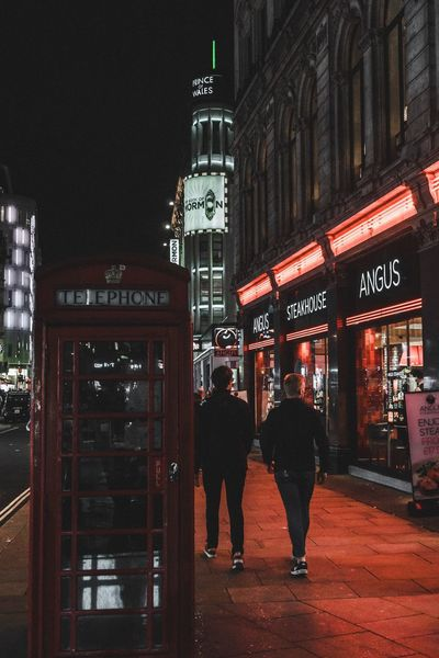 Building Exterior Architecture Western Script Built Structure Text Communication Night Illuminated Full Length Walking Men Real People Two People Outdoors Lifestyles Adult People