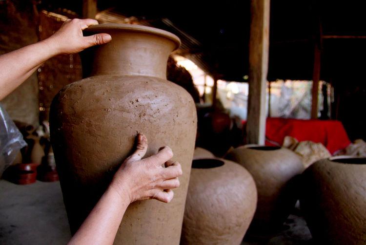 Potter Sculpting Clay Urn