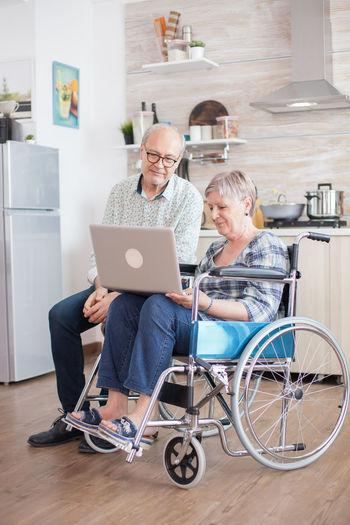 Women sitting in laptop