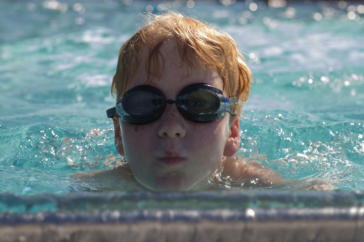 Portrait Of Boy In Swimming Pool
