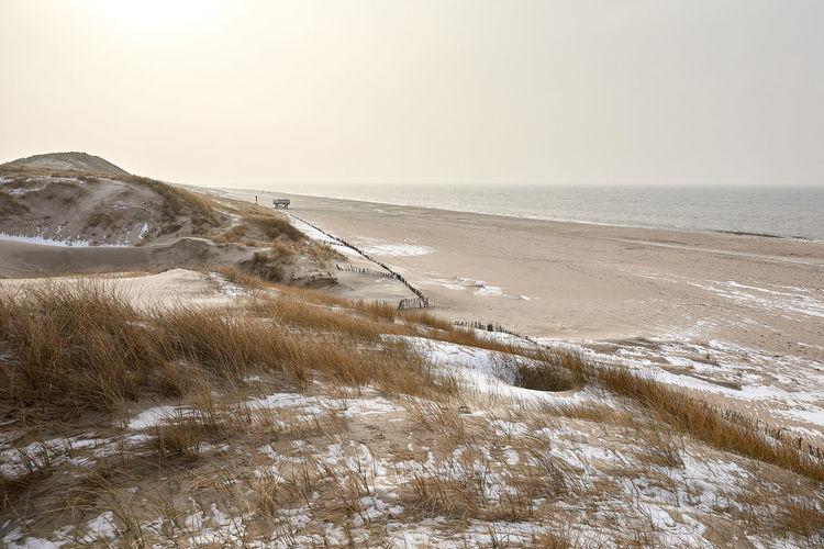 Sylt Sylt, Germany Sylt_collection Sylt Strand Winter Strand Dünen Dünengras Deutschland Landschaft Beauty In Nature Water Scenics - Nature Sea Land Horizon Over Water Tranquility Horizon Cold Temperature Sky Tranquil Scene Nature Snow Beach No People