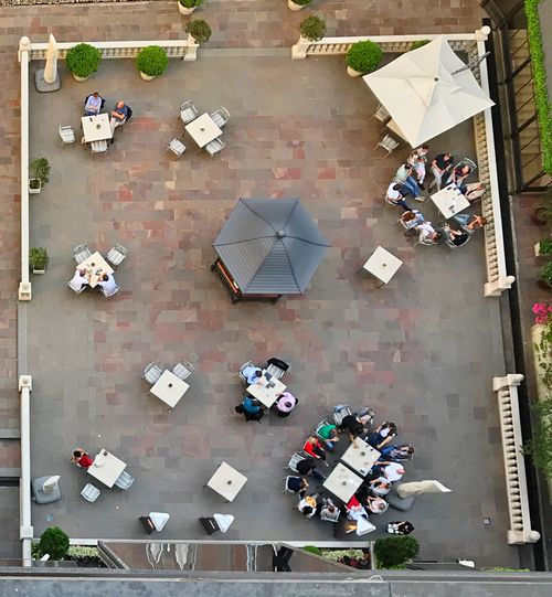 Patio Tables High Angle View City Day Architecture Group Of People Directly Above Table City Life Real People Outdoors Chair Arrangement Flooring Large Group Of People Crowd