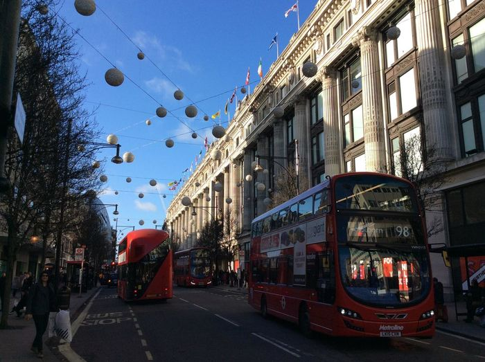 London Oxfordstreet Architecture Building Building Exterior Built Structure Cable Car Car City City Life Day Incidental People Land Vehicle Mode Of Transportation Motor Vehicle Nature Outdoors Red Residential District Sky Street Transportation