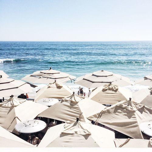 Umbrellas , the Ocean , and Horizon Over Water in Summer