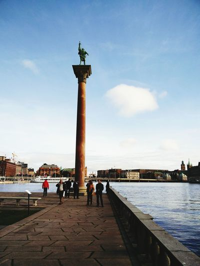 Statue Water Built Structure Architecture Sculpture Monument Tower Tourism Group Of People Architectural Column Sky Famous Place River Person Sea Tall - High Portuguese Culture Harbor Day Outdoors Sweden Sweden-Streetphotography Historic Dramatic Angles EyeEm Best Shots