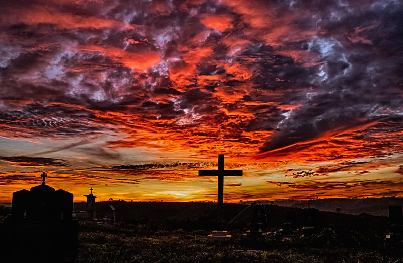 Halloween Hanging Out Beauty In Nature Built Structure Cemetery Churchyard Cloud - Sky Cross Dramatic Sky Nature No People Orange Color Outdoors Religion Scenics Silhouette Sky Spirituality Sunset Tranquility Travel Destinations