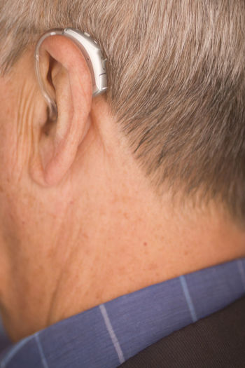 Rear view of man with eyes closed